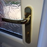 Back door with secured by design handle