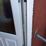 Back door with hinge protectors
